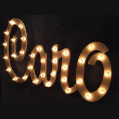 Custom wooden name with marquee lights.                    4ft wide