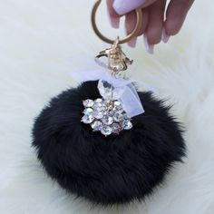 Black Fur Ball Keychain Add an extra cute piece to your wallet or keys with this adorable and trendy keychain! This small furry poof has some rhinestones to glam it up and will get you compliments all day long! Comes in black and tan❤️  bundles 2+ items get 10% off ❤️Follow me on IG: @mstanyakara Follow me on Snapchat: @tanyakara Tanya Kara Accessories