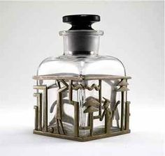 1920s Hagenauer Perfume Bottle clear and black glass, metal holder, golf theme. Hagenauer mark; Made in Austria.