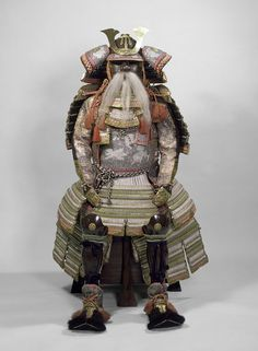 Myochin Muneharu. Date: 1859. The helmet of this suit of armour is signed 'Myochin Mondo Ki no Muneharu, on a day in the eight month of the sixth [tsuchinoto hitsuji] year of Ansei' = 1859. This armour was part of the diplomatic gift from Tokugawa Iemochi 徳川 家茂 (1846-1866), the last-but-one Shogun, to Queen Victoria in 1860, which she in turn presented to the V&A in 1865. The armour was most likely assembled specifically for the diplomatic gift. -The Victoria and Albert Museum-