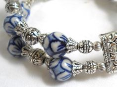Delft blue style double strand stretch bracelet made of handpainted delft blue style porcelain beads and silvertone metal beads and beadcaps. Suitable for wrists up to 17,5 cm. ( ± 7 inches)  For more jewelry please visit our shop: http://www.minouc.etsy.com  For combined shipping please contact us. We also combine shipping with our other Etsy shop where we sell vintage fabrics and finds from Holland and France: http://www.minoucbrocante.etsy.com