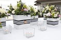 Black Nautical Wedding Theme -  Modern Nautical Wedding Flowers in Black and White Pot. Want to find matching wedding favors at discounted prices? Shop EventDazzle