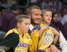 David Beckham enjoys his courtside seats with sons Brooklyn and Romeo