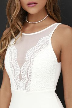 Ladies looking stunning in the Coquina Ivory Lace Bodycon Dress is a widespread phenomenon! A sheer mesh decolletage meets scalloped lace and a plunging neckline, while a low V dips at back atop a hidden zipper. Medium-weight knit fabric completes the sexy silhouette with a bodycon skirt.