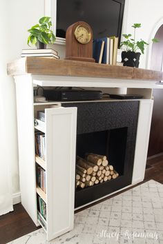 Fireplace with hidden storage! Fireplace with hidden storage! Decor, Furniture, Home Appliances, Home, Hidden Storage, Small Furniture, Space Saving Furniture, Faux Fireplace Diy, Fireplace