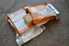 """Survival Gear Review: UST Emergency Food Ration Bars"" by Tim MacWelch 01/29/16 - The word ""ration"" usually has some negative connotations to it. Either you are rationing your food because you are running out, or you are eating rations—which are generally non-preferred food items. But what about UST's new Emergency Food Ration Bar? Would it be a good ration for an emergency, and would I still eat it if there wasn't an emergency? Let's see."