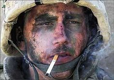 "They called him the ""Marlboro Man"", a Marine with a thousand yard stare and a smoke, taking a break during the second battle of Fallujah. Description from borepatch.blogspot.ca. I searched for this on bing.com/images"