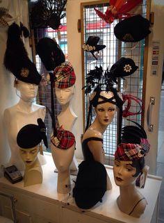 At our Portobello shop - tartan and black hat window display.  #SaraTiara #BlackHats #tartan #TartanHat #Millinery #PortobelloRoadShop #Mannequins #FeatherHeadpiece #HatWithFeather