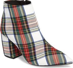 Tartan-checked ankle boots covered in cozy brushed flannel supply warm, autumnal vibes.