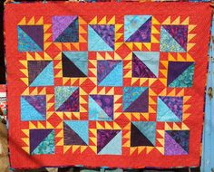 Baby quilt for Sylvie Reese. The block is called the barrister block, and her mom's a lawyer, so that was the inspiration. The color scheme came from the fabric on the back which never made it to the front of the quilt!