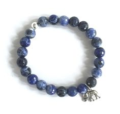 You're going to want these blues.  Elephant Charm- Sodalite Beads stretch bracelet. $25