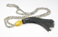 Everyone need a tassel and this one is particularly gorgeous! This hand tied labradorite necklace features a lemon quartz pendant and silk tassel ~ would add a certain seething to any outfit!