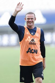 Wayne Rooney Photos Photos - Wayne Rooney of Manchester United gestures to fans during the team training session as part of their pre-season tour of China at Shanghai Stadium on July 21, 2016 in Shanghai, China. - Manchester United Pre-game Training & Press Conference