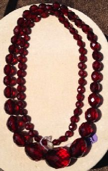 "Vintage 30"" Cherry Amber Necklace cut into faceted beads. Multi-faceted beads graduated in size from 3/8"" to over 1"". Early-mid 20th C."