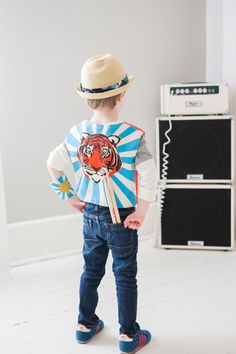 ROCK OUT in this super cool hand screen printed & sewn vest- 100% Pre-shrunk, Organic cotton, eco-friendly inks & fun snaps. The striped lining is
