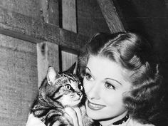 """Lucille Ball with a kitten, circa 1940. Lucy kept five cats at her 1930s residence, and six cats on her ranch with Desi. In her autobiography, she wrote, """"Cats I admire because of their independence. 'So you're home again, who gives a damn?' my cats seem to be saying when I walk in the door."""""""
