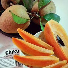 Another Tropical Fruit : Chiku Fruit, also know as ciku, sawo nilo, chikku, chiko,  lồng mứt, lamoot, 人心果 and scientifically known as Manilkara zapota or Sapodilla.  This fruit is very sweet and has a musky malty taste and has a grainy texture