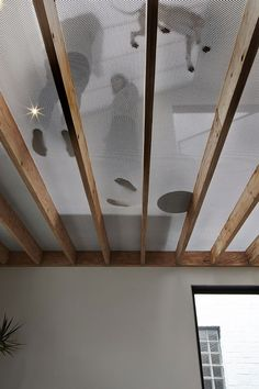 perforated metal on wooden rafters - Lightbox House by Edwards Moore