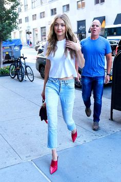 Gigi Hadid stepped out in New York City wearing the ultimate fall outfit, which included jeans, a classic white tee and bright red mules that turned heads.