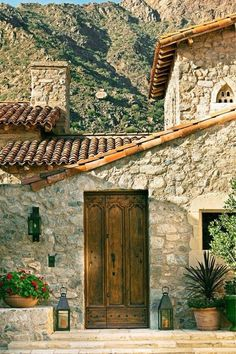 the rustic nature of the materials used to build this rural Mediterranean style residence in Paradise Valley, Arizona perfectly suits the stunning surrounds. photography by werner segarra. Antique Doors, Old Doors, Entry Doors, Entrance, Spanish Colonial, Spanish Style, Spanish Revival, Mediterranean Homes, Mediterranean Architecture