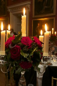 Goodwood House, Ballroom.  Tables decorated with silver candelabras with a sphere of roses and foliages.