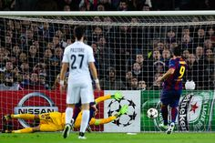 Luis Suarez of FC Barcelona scores his team's third goal during the UEFA Champions League group F match between FC Barcelona and Paris Saint-Germanin FC at Camp Nou Stadium on December 10, 2014 in Barcelona, Catalonia.