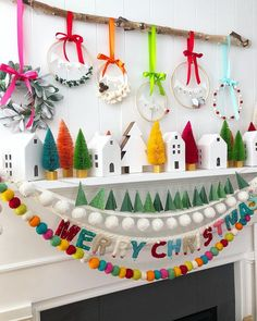 We're crushing on this colorful Christmas mantle by We just love the colors and details. She made all those cute banners with her new PINK Banner Punch Board available at retailers now! Merry Little Christmas, Christmas Love, All Things Christmas, Winter Christmas, Christmas Trees, Christmas Mantles, Christmas Fireplace, Colorful Christmas Tree, Christmas Villages