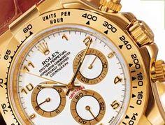 Rolex Daytona,  gold bezel, white face, croc strap