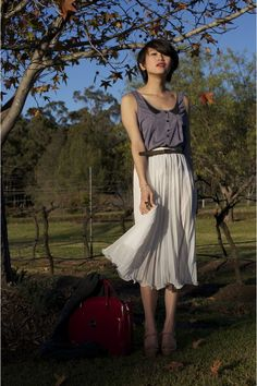 love the flowy pleated skirt. I have a feeling we're gonna see a lot of these this season!