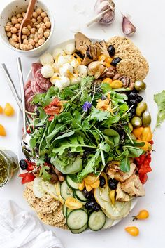 Lay out all of your favorite salad fixings on a platter instead of mixed in a bowl, and give everyone the chance to make their own favorite salad version.