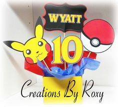 POKEMON Party Centerpiece by CreationsbyRoxy on Etsy https://www.etsy.com/listing/253350510/pokemon-party-centerpiece