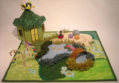 http://www.thesilverpenny.com/files/FairyTeaGardenQuilt/Fairy_Tea_Garden_Playmat_Quilt-_Large.JPG