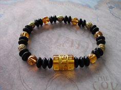 Buy Carved  ( om ) yellow quartz & black onyx tibetan guru mantra symbol bracelet by shynnasplace. Explore more products on http://shynnasplace.etsy.com