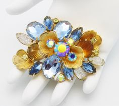 Blue and Gold Brooch by DeLizza and Elster by HeirloomBandB on Etsy https://www.etsy.com/listing/214240317/blue-and-gold-brooch-by-delizza-and