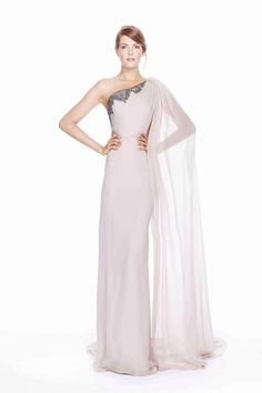 Notte Spring 2014: This is a white one shoulder Grecian goddess inspired gown with silver embellishments on the neckline and a sheer long flowy sleeve. I adore the gown! It is exquisite and glam!