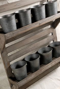 Wood rack with steel pots at save-on-crafts -- Love for herb garden on porch of storage inside...maybe kitchen storage?