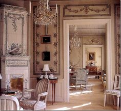 This exquisite Swedish stove as a fireplace!  and the hand=painted panels.  swoon! In both rooms!!!