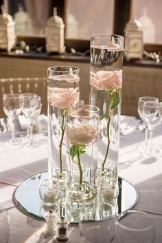 These glass, mirror and rose table centres scream contemporary romance. From Louise and Mark's real wedding in Your Berks, Bucks & Oxon Wedding issue 48. Blooms from Gingerlily Flowers (www.gingerlilyflowers.co.uk) Image: www.nigelharper.com