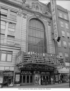 """Loew's Midland Theater, - Midland Theater entrance, marquee, and box office. Movies showing are """"El Alamein"""" with Scott Brady and """"Betrayed"""" with Clark Gable and Lana Turner. A greeting card shop abuts the theater to the north.    1954"""