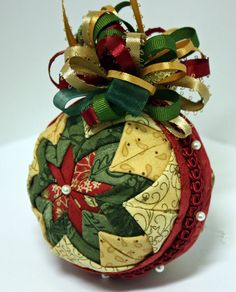 Folded Fabric Quilted Star Christmas Ornament in beige, cranberry red, and green