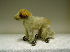 Antique Dog On Wheels. The Victorian Dog Parlour and a Victorian dog on wheels. #AmazingSpaces #Victorian #DogOnWheels http://mycoolhomepage.com/victorian-dog-grooming-parlour-and-my-amazing-spaces-dog-on-wheels/