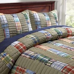 Love the taupe stripe with plaid strips.  Would make a great memory quilt ... made from old shirts ....