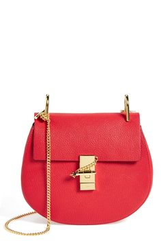 Love the gold detailing and the rounded silhouette of this red-hot Chloé leather crossbody bag.