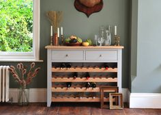 COUNTRY KITCHEN ESSENTIALS – The Cotswold Company Blog. Click  through to read the full article or PIN for later.     Chester grey wine console styled against an olive green wall, vintage gold candle sticks and pciture frames.