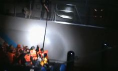 Video released by the Turkish Institute of Public Diplomacy on Friday appears to show a man on board a Greek coast guard vessel attempting to sink an inflatable raft carrying Syrian migrants in Aegean sea