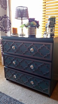 Thanks to O'verlays for helping make my plain Ikea Malm Turquoise dresser a unique addition to my bedroom with the Jasmine kit! I used Rustoleum Forged Hammered Antique Pewter paint and added mercury glass knobs from Pier1.