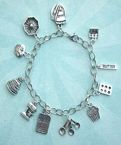 This charm bracelet features baking /baker's inspired Tibetan silver charms (nickel free). The charms are attached to a silver tone 7.5 inches chain bracelet. SKU 1311