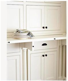 Install a pullout  A pullout counter, like this one in this pantry, offers function and flexibility. Supported by retractable brackets, the ledge makes a handy spot to assemble drinks or dessert, then slides away when not in use.  from http://www.midwestliving.com/