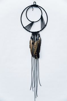 Handmade, modern dreamcatcher art.  The center hoop is 10 inches in diameter and it is 3ft 2in long from top to bottom. The Kiwi is made using black