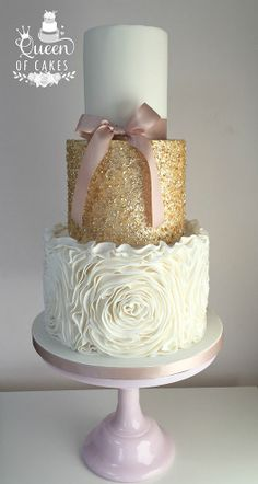 Pretty, edible gold sequin detail wedding cake with ruffle rose effect and pink detail